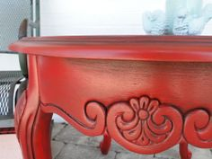 Tomato! Detail of ornate tomato red end table. Modern Vintage