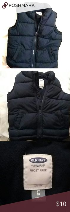 Little boys OLD NAVY puffy vest jacket This little light puffy vest jacket is sooo cute on with jeans! Or just anything! dress him up with this cute have to have for your little one vest. Color is dark blue almost looks black no visible stains due to vest being so dark of a blue color . good taken care of condition.My little one grew out of it:( OLD NAVY Jackets & Coats