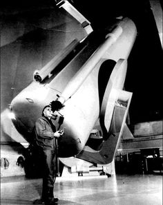Edwin Hubble, the astronomer who discovered the expansion of the universe, looking though a telescope in 1929