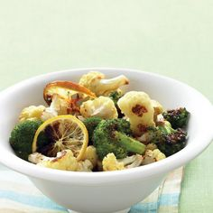 Roasted Broccoli and Cauliflower with Lemon and Garlic Recipe Side Dishes with broccoli, cauliflower, olive oil, garlic cloves, lemon, coarse salt, ground pepper