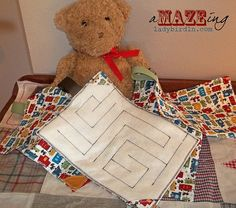 Fabric Maze--fun fabric maze with a flat gem sewn inside to keep the young ones busy on trips or at home!  Would be a great quiet book page!
