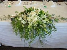 Flowers for middle of head table in between two mason jars - flat on table so don't block view of Katie & Ed. Probably want more color.