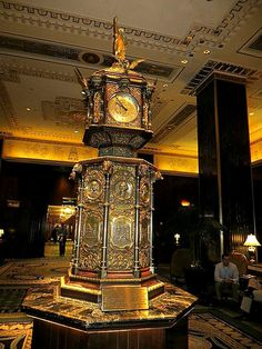 Clock tower at the Waldorf Astoria Hotel, 301 Park Avenue, New York City. Made by the Goldsmith Co. of London for the 1893 Chicago World's Fair, the tower includes images of Ben Franklin, Queen Victoria, and Presidents Cleveland, Washington and Lincoln. February 25, 2013.