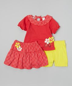 With a mix of ruffles, prints and flower accents, this charming set has plenty of flair. The peasant top ties in back, while an elastic waistband secures the comfy shorts and skirt with ease.