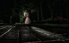 Dramatic and romantic wedding night time bride and groom portrait at arbor crest winery photo by Matt Shumate Photography