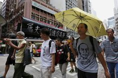 """CHINA-TIANANMEN/PROTESTS Pro-democracy protesters carrying a mock coffin and a yellow umbrella, symbol of the Occupy Central movement, take to the streets in Hong Kong, China May 31, 2015, four days before the 26th anniversary of the military crackdown on the pro-democracy movement at Beijing's Tiananmen Square on June 4, 1989. Chinese characters on the coffin read """"Notoriety to the butcher regime"""". REUTERS/Bobby Yip"""