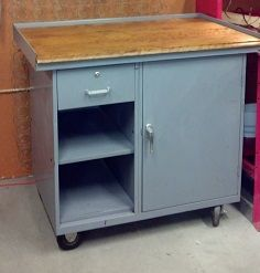 Original finish cart with wood top on wheels. $348.00