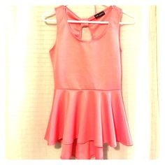 Coral peplum top Never worn!! Peplum style. Shorter in the front with a longer back Tops Tank Tops