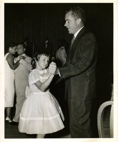 Black and white photograph depicting President Richard Nixon dancing with his daughter at an event at the Waldorf-Astoria Hotel's Starlight Roof, date unknown.