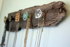 Diy Wooden Necklace Holder. Make another for earrings that is a more square piece of wood with little hooks in pairs. Use wine bottles below. Also attach something to the back so it is able to go on the hooks