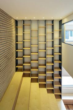 Image 5 of 28 from gallery of L_Square House / Wise Architecture. Photograph by Roh Kyung Large Bookshelves, Interior Architecture, Interior Design, Interior Ideas, Brick Detail, Stair Lighting, Architectural Section, Building Exterior, Ground Floor