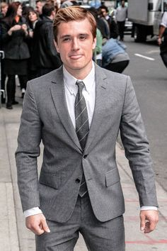 Josh Hutcherson in the gray suit, sticking out his tongue. Just too cute to pass.