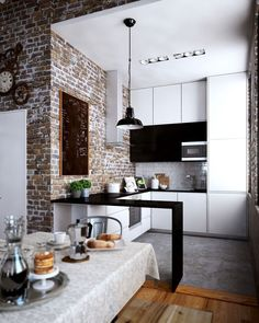 open apartment kitchen in black, white, and gray with minimalist eating bar in black.