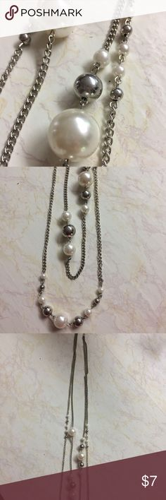 Silver and pearl long necklace Long, two-strand necklace features pearls and silver balls of varied sizes. Excellent condition. Jewelry Necklaces
