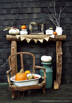 love the homemade mantel out of logs and teeny bunting.