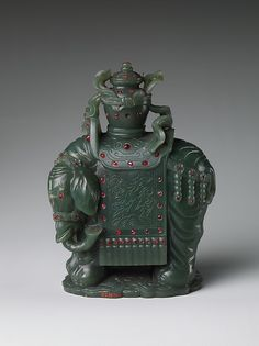 """An elephant carrying a vase was a popular decorative arts subject because of its auspicious meaning. The words for """"vase"""" and """"elephant"""" are homonymic with those for """"peace"""" and """"signs,"""" thus coinciding with a Chinese proverb: """"When there is peace, there are signs"""" (tai ping you xiang)"""