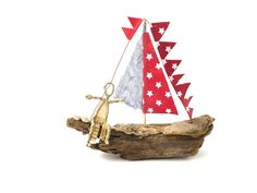 A small ship made of driftwood with sails made of paper and two real shells is an enchanting decoration for a desk or shelf.As a unique piece, it is excellent as an original gift for a birthday for sailors, marine lovers and all those who have wanderlust.An adorable eye-catcher wherever it stands.As a small business woman, I do not charge VAT**** in accordance with Section 19UstGThe ship is 15 cm long; 4.0 cm thick and 12.5 cm high.Please note: The ship is not intended as a children's toy and is Music Paper, Water Me, Sailors, Driftwood, Business Women, Catcher, Origami, Shells, Sculptures