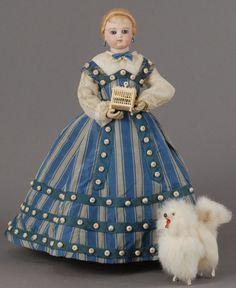Huret fashion doll, ca 1860, wears a lovely dove gray and deep blue striped