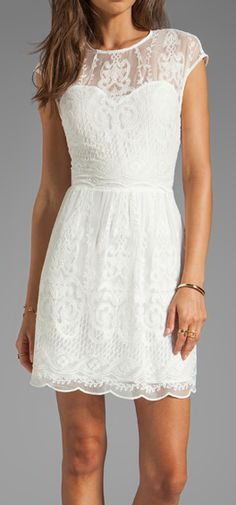 White lace dress perfect for a shower or rehearsal dinner