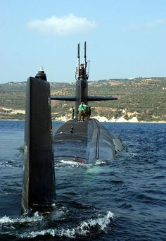 Souda Bay, Crete, Greece (Oct. 25, 2004) - The Los Angeles-class attack submarine USS Newport News (SSN 750), departs Souda Bay harbor, Greece. Newport News is homeported in Norfolk, Va., and is currently on a scheduled deployment. U.S. Navy photo by Paul Farley (RELEASED) Uss Newport News, Us Navy Submarines, Utility Boat, Nuclear Submarine, Us Navy Ships, Cabin Cruiser, Armada, Yellow Submarine, United States Navy