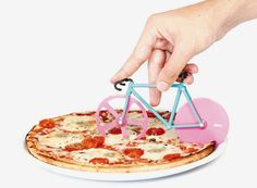 Cut Your Pie In Style: Fixie Bike Pizza Cutter. What's not to love? It's made of what appears to be thin plastic and has little grooves where cheese and sauce can dry and harden--how fun! Plus. you finally get to live the American Dream of your fingers riding a tiny bike across a pizza.