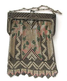 """Gorgeous silver-tone circa 1920s mesh purse enameled in lovely shades of green and peach with black accents. The frame has a geometric pattern so typical of the Art Deco era. The bottom of the purse ends in eight points. Silver-tone chain handle and crossover clasp. Has Whiting & Davis hangtag and is in excellent condition with minimal to no enamel loss. Fabulous! Measures 7"""" x 5""""."""