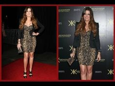 Khole looking very stylish in her lepoard print dress and a short blazer
