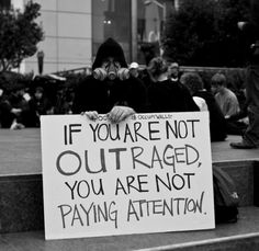 "protest ""if you are not outraged you are not paying attention"""