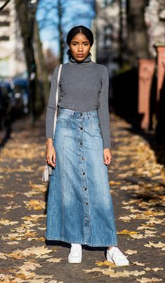Tuck your turtleneck into a long denim skirt, and finish the look off with a pair of sneakers.