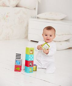 nine colourful stacking cubes with lots for baby to discover