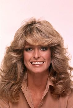 In 1976, Farrah Fawcett posed for a swimsuit poster that would sell a record-breaking 12 million copies. With her red one-piece and lustrous feathered waves, she embodied the quintessential California girl. That image launched the career of her hairstylist Allen Edwards, and led to Fawcett's role on Charlie's Angels — as well as a line of Farrah Fawcett shampoo. Now her Norma Kamali one-piece is part of the Smithsonian's permanent collection.