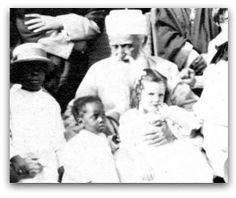 On June 18, 1912 a motion picture was made of 'Abdu'l-Bahá at the Brooklyn home of Howard and Mary MacNutt. This photograph of 'Abdu'l‐Bahá with children is a still from that original film.