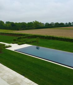 Modern pool in the Hamptons by Howard Design Studio.