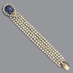 AN ANTIQUE PEARL, SAPPHIRE AND DIAMOND BRACELET -  The five-row pearl bracelet to the cabochon sapphire and diamond pear-shaped clasp, pearls untested, mounted in silver and gold, circa 1870