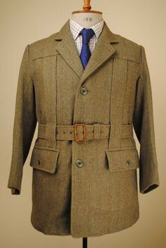 Norfolk Jacket: Two pleats coming down the front with a belt, worn by men. A loose belted jacket with box pleats, typically made of tweed
