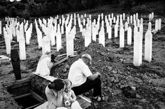 Paolo Pellegrin Families of victims mourn at the Srebrenica-Potocari Memorial on the 17th anniversary of the Srebrenica massacre. The Bosnian government held enclave of Srebrenica was put under UN protection in 1993. In July 1995 the Dutch UN forces in Srebrenica surrendered to Bosnian Serb forces, paving the way for a massacre to commence. Over the next few days over 8,000 Bosnian males of all ages were hunted down and executed in the surrounding area.