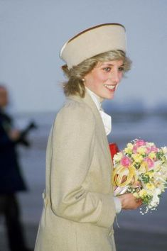 The princess showcased a light-hued palette — a camel coat, creme tie-neck blouse, and camel-trimmed cossack hat — while arriving at the East Midland airport in Coventry on October 16, 1985. She was there to visit one of her charities, Remploy, which provides employment placement services for disabled people.