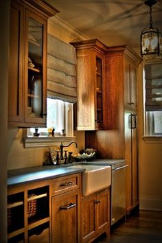 Beautiful kitchen with oak cabinets, farmhouse sink, and slate countertops.