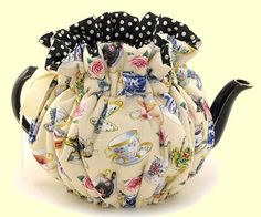 A Tea Cozy with Tea Cups over a Tea Pot.....doesn't get much betta than that!