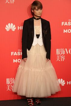 Singer Li Yuchun poses at the Vogue China 11th anniversary gala on November 3 in Beijing.  http://www.chinaentertainmentnews.com/2016/11/vogue-china-11th-anniversary-gala-held.html