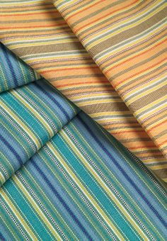Shoals Striped Fabric - The colors of North Carolina's ocean currents, soft sands and sea grass mingle for a leisurely yet timeless look. Make your own retreat indoors with these relaxing, seacoast-inspired stripes in warm shades.