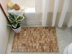 Bathroom Decor: DIY Wine Cork Bathmat. cool also need white shower curtain to brighten bathroom