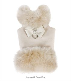 Designer Susan Lanci adds an Ultrasuede Nouveau Bow to a microsuede fur trimmed jacket for the perfect dog harness jacket for fashionable winter walks with your dog.