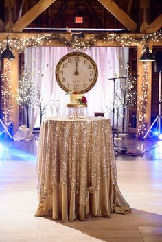 Charlotte new years eve wedding from kristin vining photography dramatic glitter linen cake table whole foods aldena frye floral design martha stilwell junglespirit Image collections