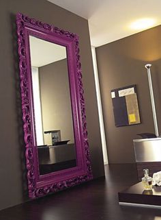Paint an oversized mirror in a bright hue for a pop of color~love this with the grey walls!
