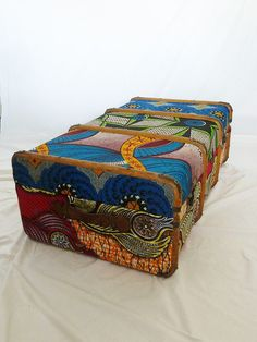 Old upholstered trunk in African fabrics.