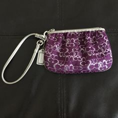 Authentic Coach Signature Lurex wristlet Authentic Coach Purple and silver Signature Lurex wristlet. Used once or twice. In excellent condition as seen in pictures. Coach Bags Clutches & Wristlets