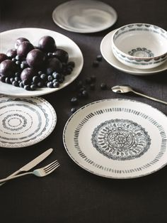 Add patterned plates and bowls to liven up your kitchen crockery keeping colour simple.