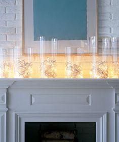 Holiday lights coiled in bottomless hurricane lamps. Simple and chic!