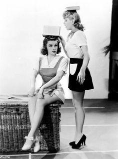 Judy Garland and Lana Turner work on their posture